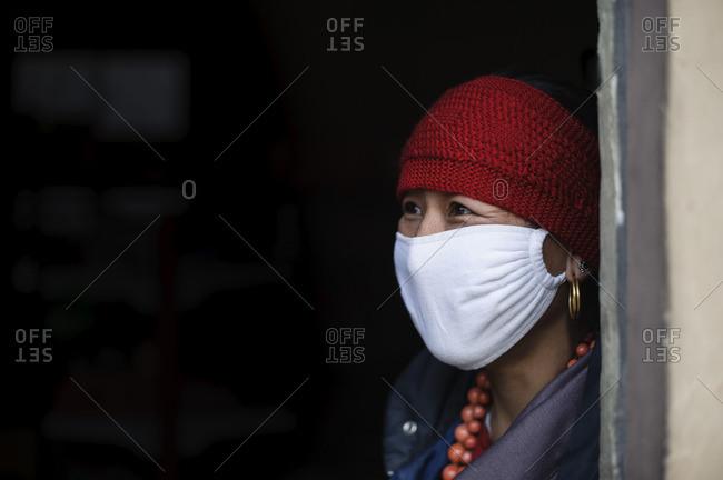 April 3, 2011: Tibetan woman with face mask, Tibetan plateau