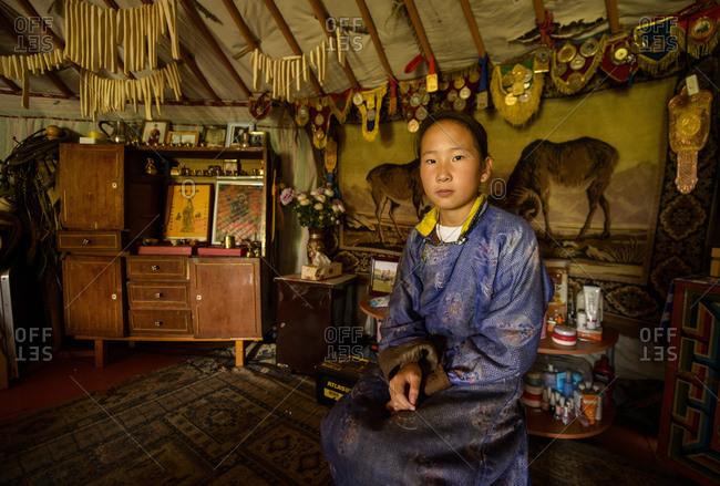 August 16, 2013: Mongolian nomad girl in her yurt, Mongolia