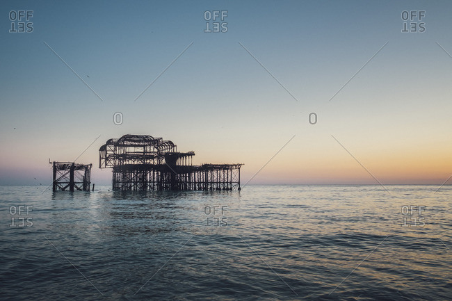 Blown West Pier at the Sea at Dusk, Brighton, England
