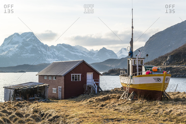 Hut with fishing boat in Fredvang on Torsfjord, Lofoten, Norway