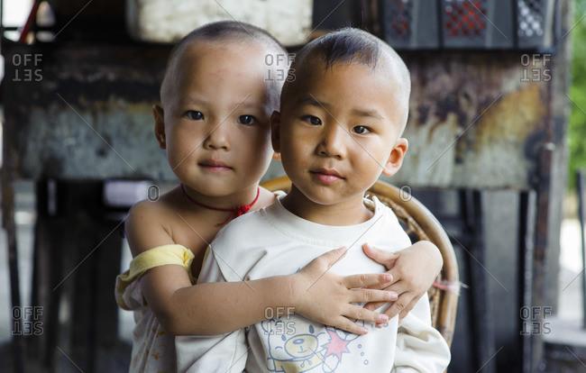 June 10, 2011: Bulang ethnic minority children. Xishuangbanna, Yunnan, China