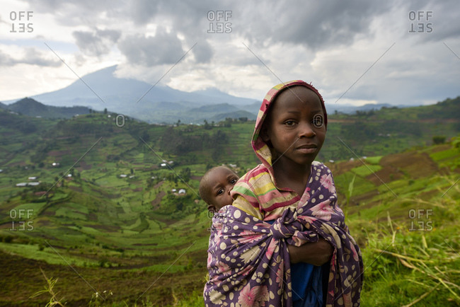 October 22, 2014: Girl with baby, Virunga region, Uganda, Africa