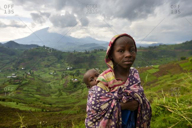 October 22, 2014: Girl with baby, Virunga region, Uganda, Africa