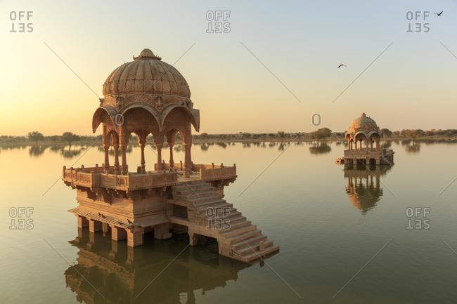 Sunrise and temple Gadi Sagar, Gadisar Lake, Jaisalmer, Rajasthan, India
