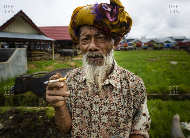 April 9, 2013: Toraja man at the cattle market, Sulawesi, Indonesia