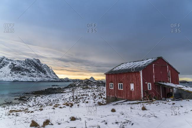 Fjord landscape with fishing hut near Gunnarholmen, Skarvagen on Vesteralen, Norway