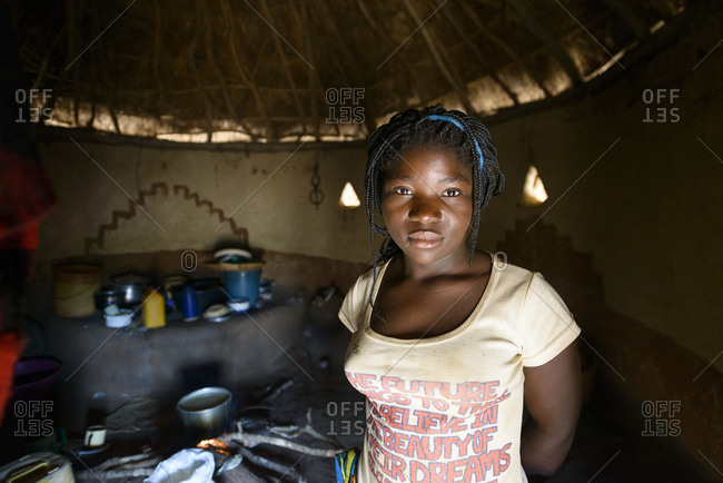 January 13, 2015: Young woman in traditional straw hut, Mozambique, Africa
