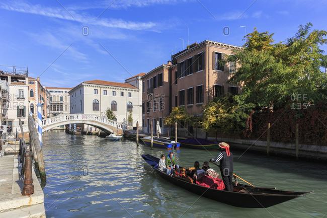 November 6, 2015: Gondola ride in the Castello district, Venice, Italy