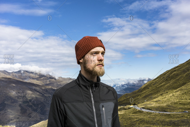 Portrait of a young man on Crown Range Road, New Zealand