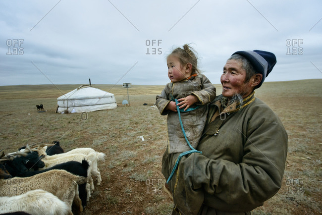 September 18, 2013: Grandfather and granddaughter in the Gobi Desert, Mongolia