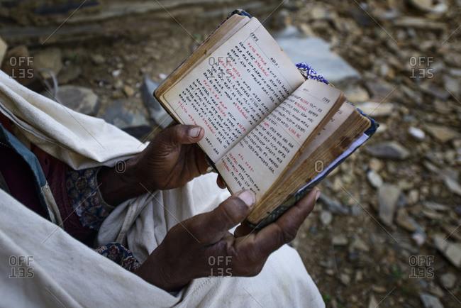 June 28, 2014: Ethiopian Orthodox Church priest reads the Bible, Tigray, Ethiopia