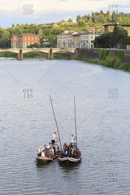 May 17, 2014: Excursion boats on the river Arno, Florence, Tuscany, Italy