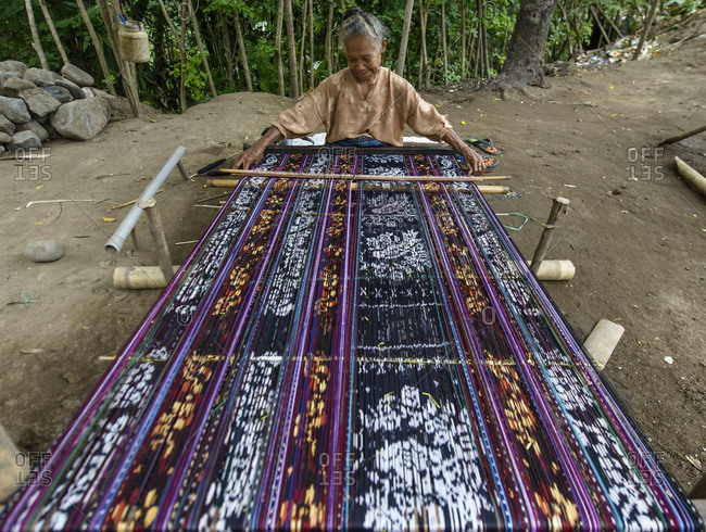 May 25, 2013: Woman from West Timor works on an Ikat, Indonesia