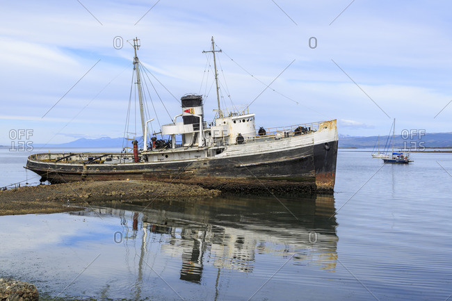 November 20, 2016: Shipwreck Saint Christopher in the port of Ushuaia, Argentina