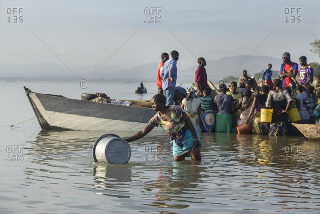 November 21, 2014: People at fish market on Lake Malawi, Malawi, Africa