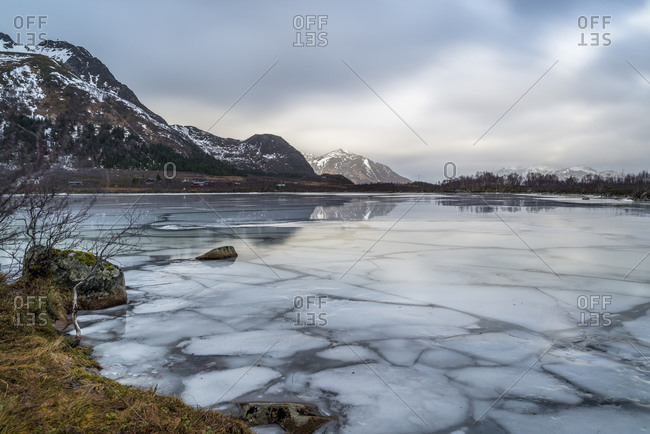 Rotvatnet lake with ice floes on the island of yksnes, Vesteralen, Norway