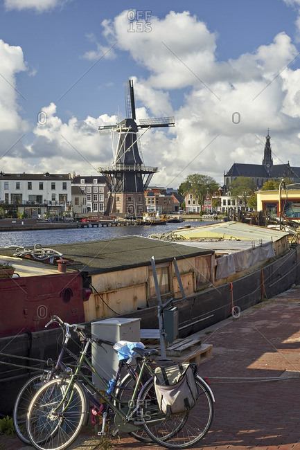September 14, 2017: Adriaan windmill with houseboat in Haarlem, North Holland, Netherlands