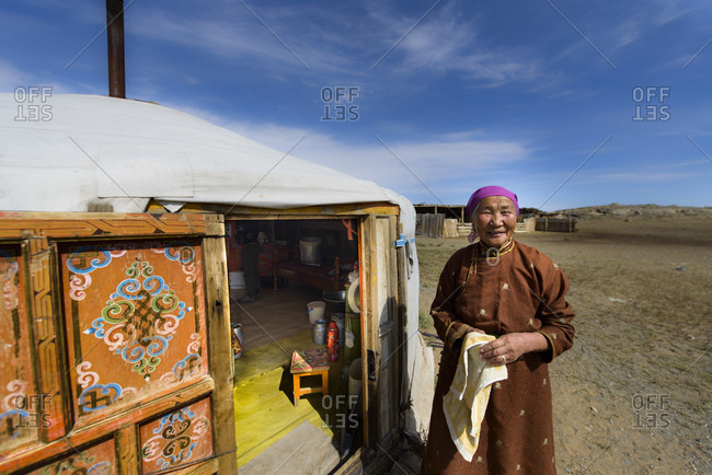 September 17, 2013: Mongolian nomad woman in front of her yurt, Mongolia
