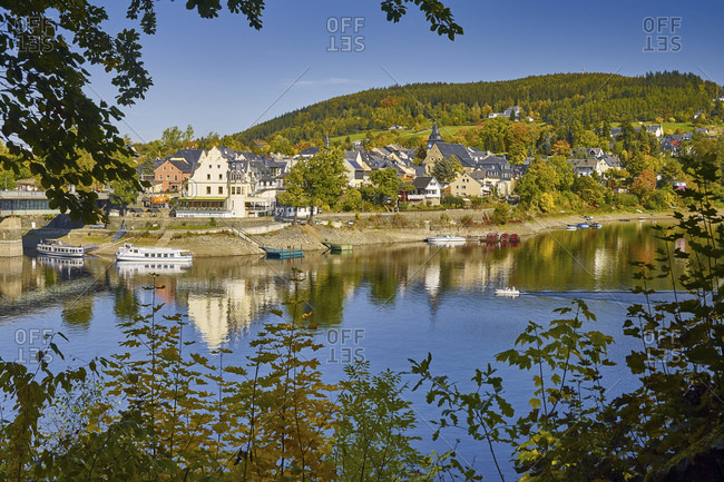 View of Saaalburg at the Bleilochtaalsperre with boat landing stage, Thuringia, Germany