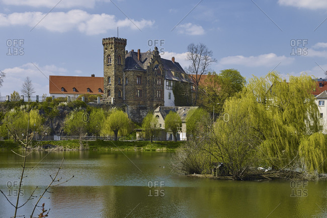 View over the bathing pond to the New Castle, Ronneburg, Thuringia, Germany