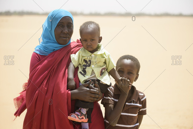 April 30, 2014: Nubian mother with her two sons in the Sahara, Sudan