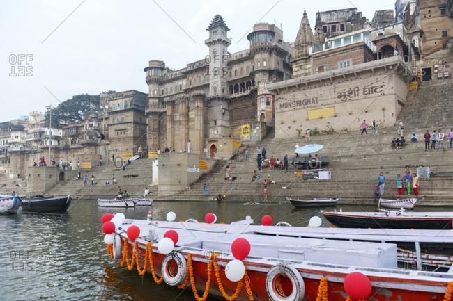 February 21, 2016: Pilgrims at Munshighat on the Ganges, Varanasi, Uttar Pradesh, India