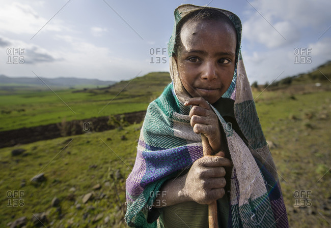 June 16, 2014: Ethiopian children work in the fields of the highlands, Ethiopia