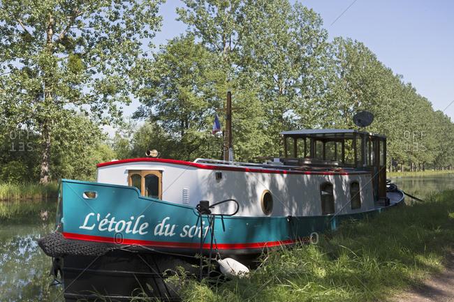 June 23, 2016: boat L'etoile du soir, Saint-Jean-de-Losne, Canal de Bourgogne, Burgundy, France