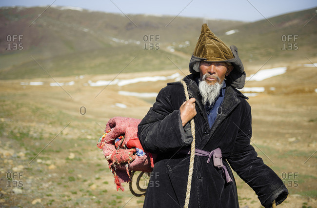 May 17, 2010: A nomadic man walking in remote Tian Shan range. Xinjiang