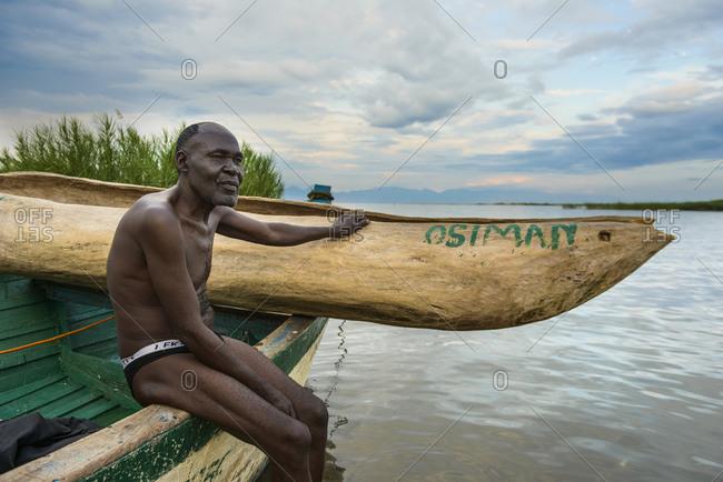 November 20, 2014: Fisherman sits on his boat on Lake Malawi, Malawi, Africa