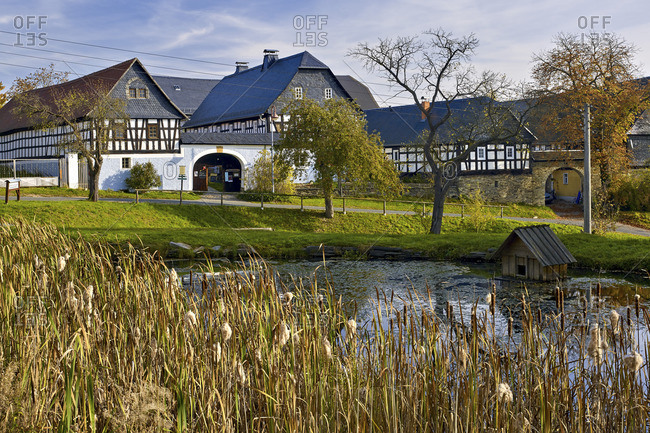 October 18, 2017: Nitschareuth, historic village green with Vierseithofen near Greiz, Thuringia, Germany