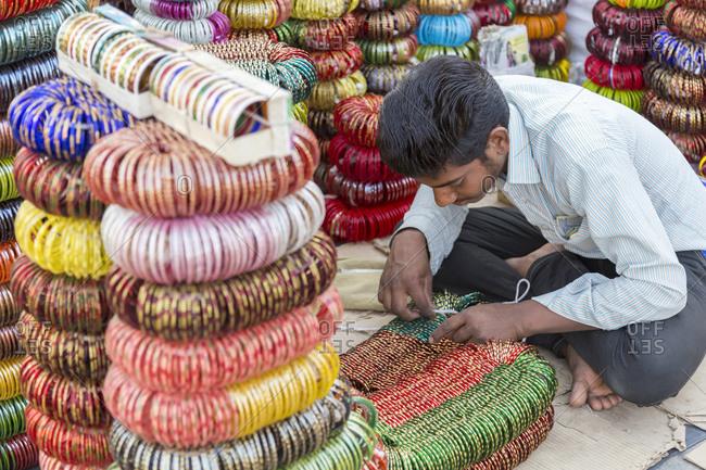 February 12, 2016: Selling bangles, Girdikot and Sardar Market, Old Town, Jodhpur, Rajasthan, India