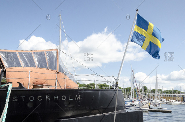 July 11, 2015: Bow of a ship with Swedish flag, harbor, Stockholm, Sweden, Europe