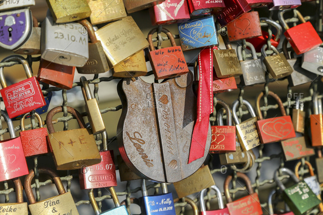 March 11, 2014: Love locks and Hohenzollern Bridge, old town, Cologne, North Rhine-Westphalia, Germany