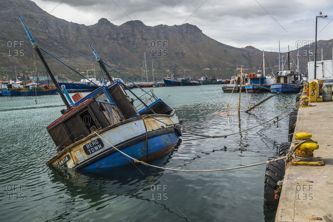 March 5, 2017: Sunk fishing boat in Kalk Bay harbor, False Bay, South Africa