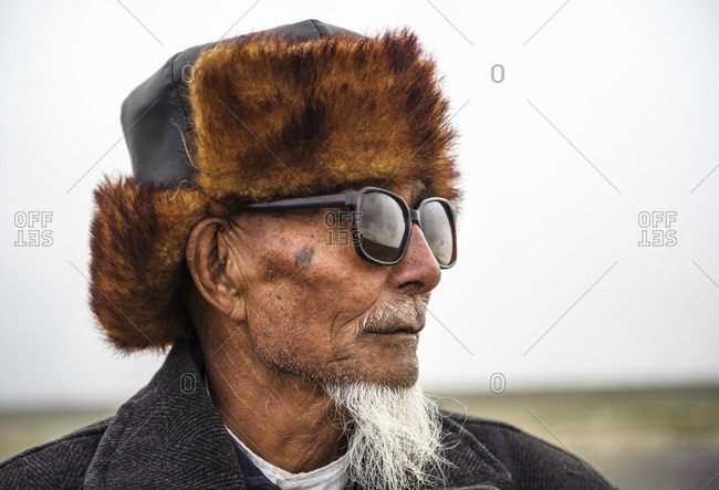 May 16, 2010: Mongolian men in China of the Meng ethnic minority, Xinjiang. China