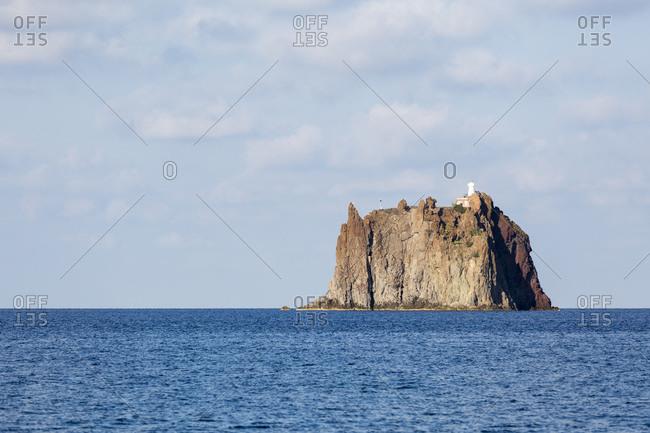 The Strombolicchio, the volcanic island of Stromboli offshore rock island, Aeolian Islands, Sicily, Italy