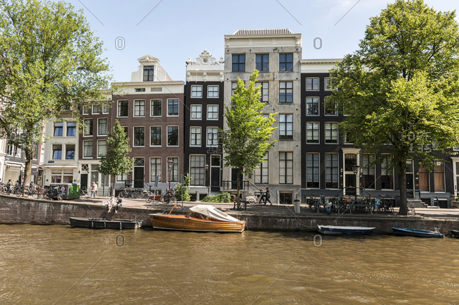August 9, 2015: Historic gables and facades of the canal houses, old town, Amsterdam, Netherlands