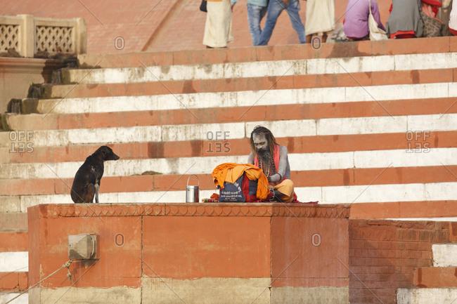 February 21, 2016: Sadhu on the Main Ghat on the Ganges, Varanasi, Uttar Pradesh, India