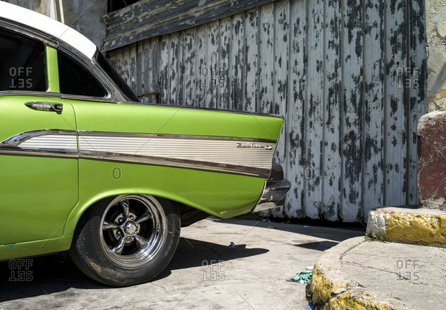 October 8, 2015: Chevrolet Bel Air in front of a warehouse at Havana harbor, Cuba