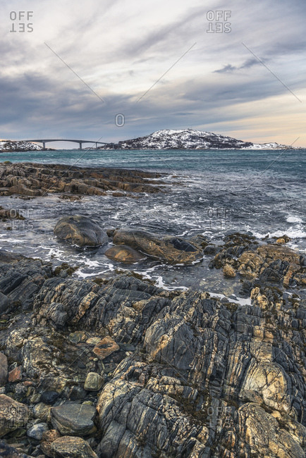 Coastal landscape of the island of Kvaloya with a view of the island of Sommaroy, Norway