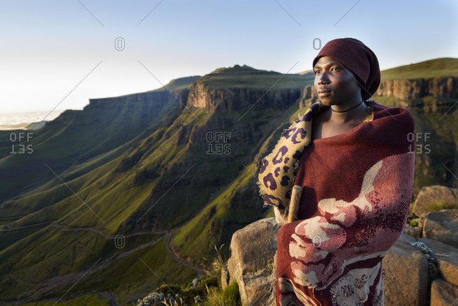 February 12, 2015: Basotho shepherd with view of Sani Pass, Drakensberg Mountains, mountain range, Lesotho, Africa