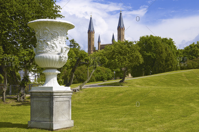 June 20, 2015: Vase with castle church in the castle park of Neustrelitz, Mecklenburg-West Pomerania, Germany