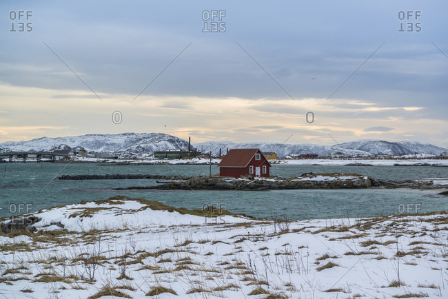 Coastal landscape of the island of Kvaloya with a view of the offshore island of Sommaroy, Norway