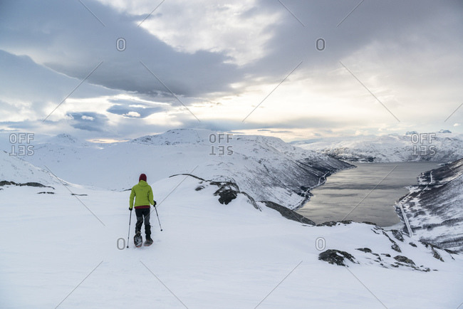 February 21, 2016: Snowshoeing on the island of Kvaloya with a view in the northern fjords, Norway