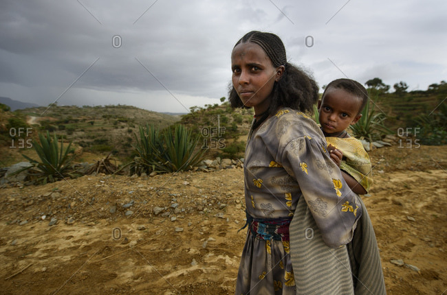 June 26, 2014: Tigrayan girl with her baby, with typical Ethiopian Orthodox tattoos on her forehead, Ethiopia