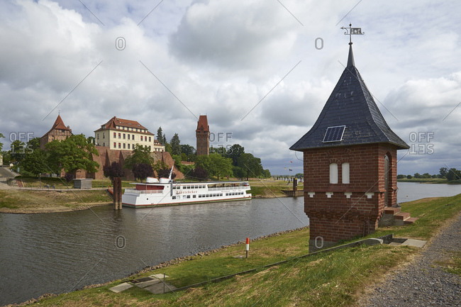 June 19, 2015: Level house with a view over the Elbe to the castle of Tangermunde, Saxony-Anhalt, Germany