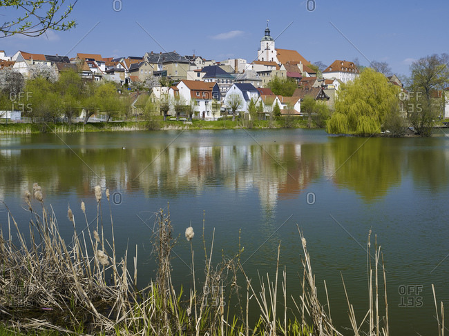 Panoramic view over the bathing pond to the old town with the church St. Marien, Ronneburg, Thuringia, Germany