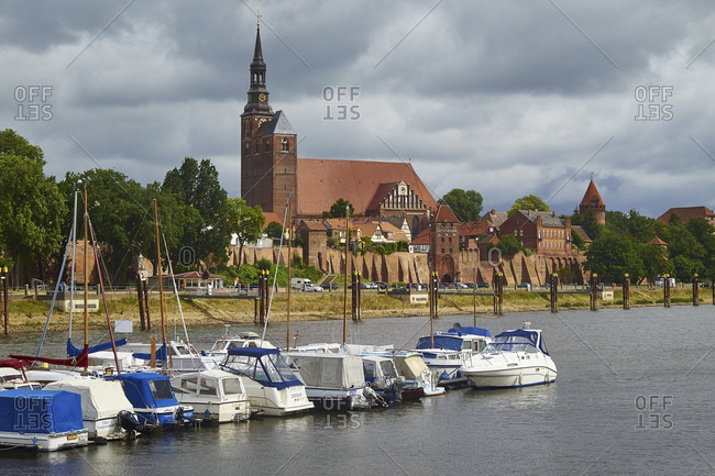 June 19, 2015: View over the river Elbe to the old town with church St. Stephan, Tangermunde, Saxony-Anhalt, Germany