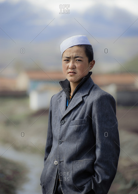 May 22, 2010: A young boy from the Hui ethnic minority posing by his village of Men Yuan in Qinghai. China.
